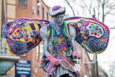 Photo by Emma Warley  Yesterday the Bathing Belle statue in Scarborough, England, got a new look! A local crochet artist calling herself Higgle decided Belle needed a fun make-over. Hi...