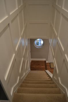 board and batten staircase   ... the paneled look (wainscotting? Board and batten?) of the hallway More
