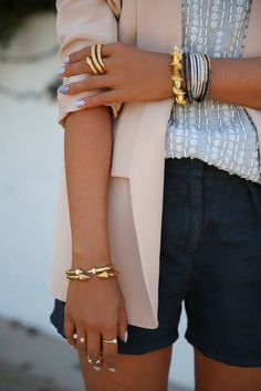 Add this minimal gold spike cuff to your arm party for an edgy and glam impact. Adjustable size 18K gold plated metal