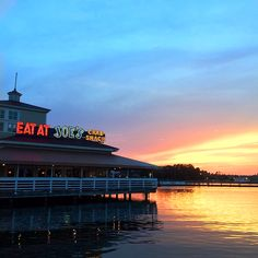 Waterfront dining at Joe's Crab Shack in North Myrtle Beach, South Carolina with a sunset view. (Photo via Instagram by  @turquoise_wanderer - Click on the pin to see additional places to dine in the Myrtle Beach area)