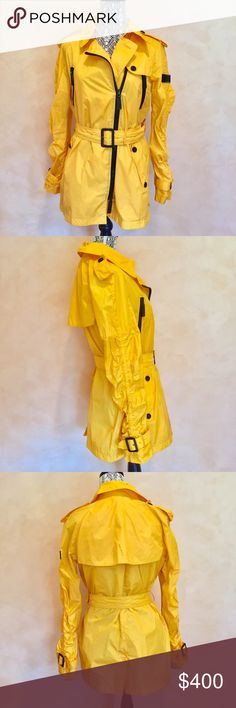 BURBERRY SPORT RAIN JACKET Very cool! Nylon Yellow with black hardware sport rain jacket. Convenient multiple pocket and belt accent detail. Fits true to size. Comes from a pet and smoke free home. OFFERS WELCOME! Burberry Jackets & Coats