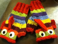 Ravelry: Fishy Fingerless Mitts pattern by Sarah Paterson