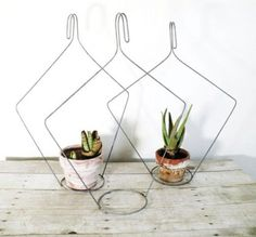 I have so many wire hangers... now I know what to do with some of them.  25 Lovely DIY Hanging Planters