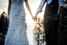 Bride & Groom, holding hands.