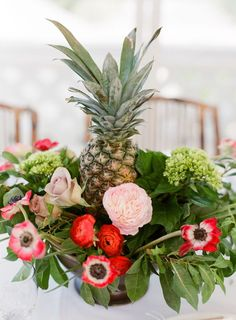 Tropical pineapple accented table decor: http://www.stylemepretty.com/destination-weddings/2015/11/16/sophisticated-harbour-island-wedding/ | Photography: Almond Leaf Studios - http://almondleafstudios.com/