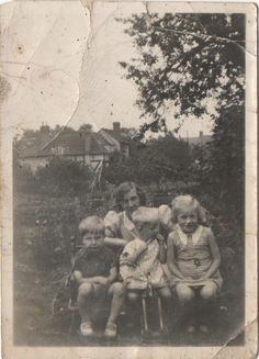 My Nan with My Dad (left) and his brother & sister.