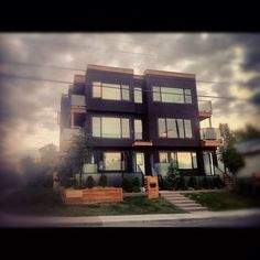 #fourplex located in #calgary is an example of #modern #prefab #homes designed and built by Karoleena homes.