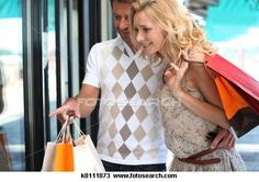 Stock Photo of Couple shopping k8111873 - Search Stock Images, Poster Photographs, Pictures, and Clip Art Photos - k8111873.jpg