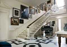 Prestigeous Mansion Foyer & Staircase with Gallery Wall along the staircase wall.
