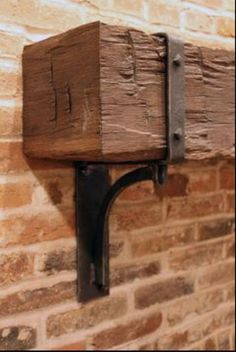 Iron bracket for cedar fireplace mantle.
