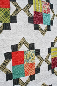 By Lee @ Freshly Pieced Love the black corner squares and the points made by the flying geese.