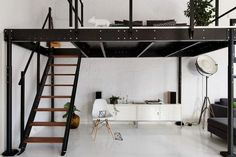 lit mezzanine en métal noir, chaise design en bois et blanc, sol en grès cérame assorti et meuble de rangement blanc neige