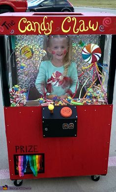 Tiffany: My daughter Hynder, is wearing this costume. It is a candy claw machine. We built this with a tool roller and lumber. We finished it up by gluing lights in...