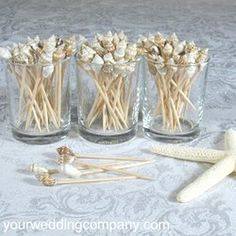 Seashell toothpicks - Great for beach or tropical themed weddings and luau parties. via www.yourweddingcompany.com