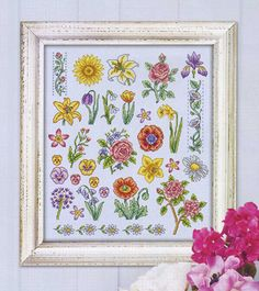 Flower motifs sampler made-up and framed.