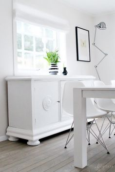 second hand, whitepainted cupboard ... Love the mix.... Modern chairs ..... and love the lamp