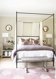 bedroom, matching nightstands, iron four poster bed, white bedding, purple blanket, purple rug