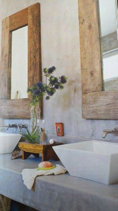 Love the reclaimed wood mirrors and the industrial concrete counter top.