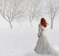 Sandra Cunningham RED HAIRED WOMAN IN WHITE DRESS IN SNOW