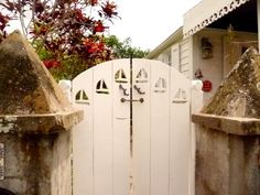 Wood gate with sailboat cutouts in Saba, Antilles, Dutch Caribbean. #boatonlakebackyards