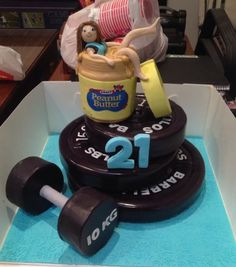 Gym Themed Cake The Weight Plates Are Mud Cake The Peanut Butter Jar Is Made From Ricekrispies And So Is The Dumbbell on Cake Central