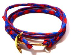 """This wrap bracelet is the """"it"""" bracelet for men. The bracelet is handmade using red and blue paracord cord and is accentuated by stunning gold plated large anchor bead. This very hip bracelet has a wraparound rope one size fits most.        Mystical power: Anchor is said to promote steadiness and loyalty.    Product Details      - Paracord cord    -length 22 inches    -Adjustable size 7inches…"""