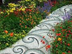 Oh my!  How beautiful is this?  A mosaic path through the flowers!  View larger here:  http://2.bp.blogspot.com/_jJl7d_jqe90/TLG2BhW0TgI/AAAAAAAAAmk/dwpwX-7fbEE/s1600/pebble-mosaic--flower-path.jpg OR http://pictures-flowers-online.blogspot.com/2010/10/pebble-mosaic-flower-path.html