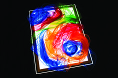 Create art with scarves on a light box.