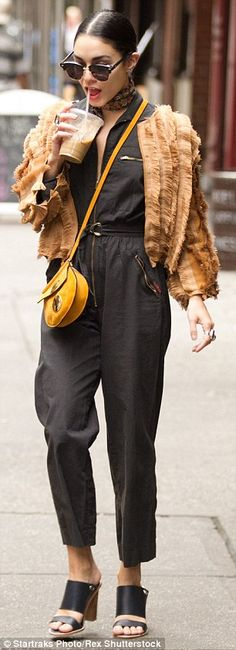 Furry fashionable: The star stood out with a cropped shaggy brown jacket...