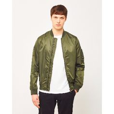 Green Lightweight Nylon MA-1 Bomber Jacket : Green lightweight nylon MA-1 bomber jacket . Here is a contemporary piece that'll make your outfit fit for the modern day. This bomber jacket that's just dropped in from our very own Idle Man range is a consistent hit. Sporting all the marks of an original, you know you're in for a winner. Zip pocket on arm with pen holders. Snap closure pockets. Placket underneath zip.