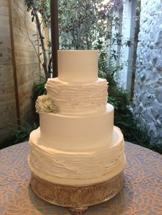 Creme de la Creme Cake Company. Wedding cake with Petal Texture. Four Tiered Brides Cake. Simple Elegance.