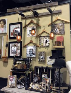 here is how Tim Holtz used old wooden hangers to display artwork and a neat way to hang the lights