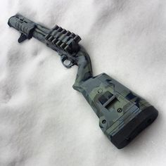 Gray-brown camo on Magpul stocked Remington 870