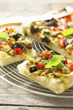 This recipe for Flatbread with Eggplant, Tomatoes, and Goat Cheese makes good use of the last of summer's bounty.