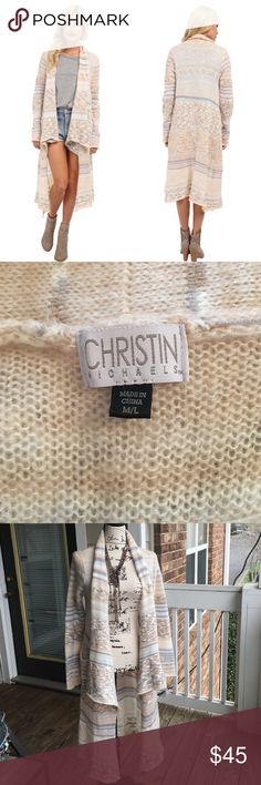"""Christin Michaels Kara Striped Cardigan A ladylike cardigan that brings you the chic look you've been searching for! SIze:  M/L Lightweight knit with a bold tribal stripe throughout. Open-front design gives a glimpse of your fabulous ensemble underneath. Long sleeves. Relaxed fit. Handkerchief hemline at a tunic length. 70% acrylic, 30% wool. 43"""" long christin michaels Sweaters Cardigans"""