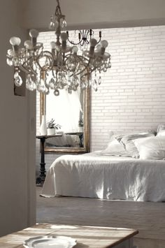 White brick wallpaper in a soothing linen bedroom. From Wallquest White on White Collection.