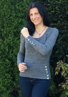 This Push My Buttons by Mary Annarella is a basic scoop-neck sweater but what makes it are the button accents on the hip and cuffs. For button addicts only!