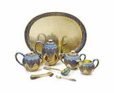 A SILVER-GILT AND CLOISONNÉ ENAMEL TEA AND COFFEE SERVICE MARKED GRACHEV WITH THE IMPERIAL WARRANT, MOSCOW, CIRCA 1890