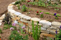 Create definition in your outdoor space using stone slabs to outline your flowerbed. #DIY #Outdoor Living #Flowerbed