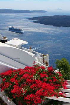 Blue, White & Flowers of Santorini , Greece See the huge cruise ship out in the water? Just gives you an accurate idea of the size of this place. Santorini Greece, Mykonos, Santorini Island, Beautiful Places To Visit, Wonderful Places, Greece Honeymoon, Beau Site, Greece Islands, Greece Travel