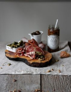 If someone handed this to me in the restaurant just like that-- it would be heaven. The tumbling of the meat on the board with pickles and olives and a jar of deliciousness