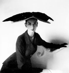 Model wearing a hat and suit by Balenciaga, Paris, 1948, photo by Clifford Coffin