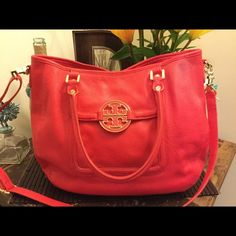 Authentic Tory Burch Red Amanda Tote Bag Authentic Large Tory Burch Amanda Tote. Beautiful pebbled leather carnival red with gold hardware.  This bag is in new condition with one small (quarter size) spot as seen in first pic. The handles are perfect. The hardware is perfect. Interior is perfect. It also has cross body strap that is detachable. Tory Burch Bags