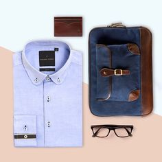 """The Alden Folio from @gnomenbow is ideal for storing your working documents, and comfortably fits your 13"""" laptop. The deep navy color adds a touch of class to the façade lending an old world charm to a modern accessory. It pairs beautifully with our button-down cotton Oxford shirt. Visit our stores for these great new offerings. #benjaminbarkerstore #benjaminbarker #productstyling #flatlay #menswear #dapper #GQ #esquire #sartorial"""