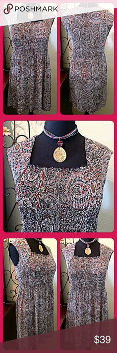 "💐Pretty Paisley Print Capped Sleeve Dress💐 Perfect dress for travel, a party, or casually. It's an adorable dress that has a shoulder span/capped sleeve look. The center area is stretchy gathered & falls over the body. Relaxed fit. Paisley print w/reds, browns, black & off white colors. Measurements:Bust=36"" unstretched, Shoulder Span=17.25"", Length from Shoulder=36-37"". I'm 5'6"" and it comes just above my knees. Size 10. NWOT. Dress Barn Dresses"