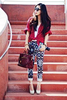 Totally in love with the pop of red this shirt is adding to this whole outfit! CUTE!!! her pants