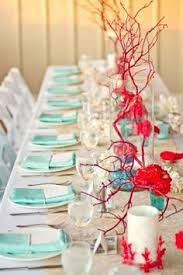 Spray paint branches to make them look like coral for under the sea | Bridal Guide Magazine