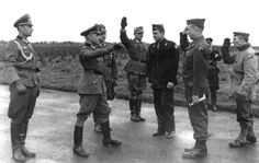 Negotiations for POW swap, German and American officers along with Red Cross facilitator, Andrew Gerow Hodge who set the whole thing up - Nov. 15, 1944, Brittany, France. 149 prisoners from each side were exchanged.