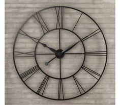 rh iron clock over fireplace