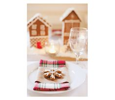 Table with gingerbread centerpiece, plaid napkins with gingerbread cookies